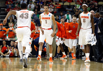 PITTSBURGH, PA - MARCH 17:  (from right) C.J. Fair #5, Michael Carter-Williams #1 and James Southerland #43 of the Syracuse Orange celebrate after a second half dunk by Syracue against the Kansas State Wildcats during the third round of the 2012 NCAA Men'