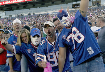 ORCHARD PARK, NY - OCTOBER 09: Fans of the Buffalo Bills celebrate a win against the Philadelphia Eagles at Ralph Wilson Stadium on October 9, 2011 in Orchard Park, New York. Buffalo won 31-24.  (Photo by Rick Stewart/Getty Images)