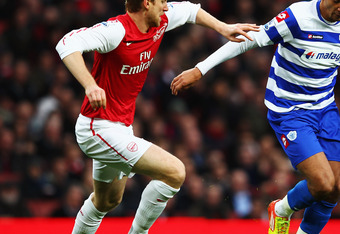 LONDON, ENGLAND - DECEMBER 31:  Jay Bothroyd (R) of Queens Park Rangers holds off the challenge of Per Mertesacker (L) of Arsenal during the Barclays Premier League match between Arsenal and Queens Park Rangers at the Emirates Stadium on December 31, 2011