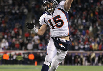 FOXBORO, MA - JANUARY 14:  Tim Tebow #15 of the Denver Broncos throws a pass against the New England Patriots during their AFC Divisional Playoff Game at Gillette Stadium on January 14, 2012 in Foxboro, Massachusetts.  (Photo by Jim Rogash/Getty Images)