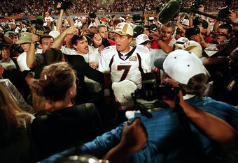 31 Jan 1999:   John Elway #7 of the Denver Broncos talks to reporters after the Superbowl XXXIII against the Atlanta Falcons at the Pro Player Stadium in Miami, Florida. The Broncos defeated the Falcons 34-19. Mandatory Credit: Rick Stewart  /Allsport