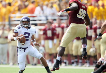 CHESTNUT HILL, MA - SEPTEMBER 03:  Kain Colter #2 of the Northwestern Wildcats scrambles as Dominic Appiah #95 of the Boston College Eagles defends on September 3, 2011 at Alumni Stadium in Chestnut Hill, Massachusetts.  (Photo by Elsa/Getty Images)
