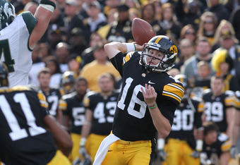 IOWA CITY, IA - NOVEMBER 12:  James Vandenberg #16 of the Iowa Hawkeyes has his pass knocked down by Marcus Rush #44 of the Michigan State Spartans at Kinnick Stadium November 12, 2011 in Iowa City, Iowa. Michigan State beat Iowa 37-21.  (Photo by Reese S