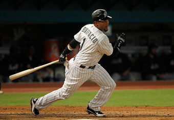 MIAMI GARDENS, FL - SEPTEMBER 05:  Emilio Bonifacio #1 of the Florida Marlins hits during a game against the New York Mets at Sun Life Stadium on September 5, 2011 in Miami Gardens, Florida.  (Photo by Mike Ehrmann/Getty Images)