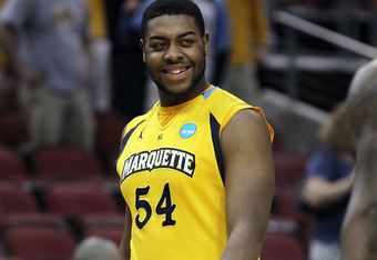 LOUISVILLE, KY - MARCH 15:  Davante Gardner #54 of the Marquette Golden Eagles smiles towards his teammate Jamail Jones #22 against the Brigham Young Cougars during the second round of the 2012 NCAA Men's Basketball Tournament at KFC YUM! Center on March
