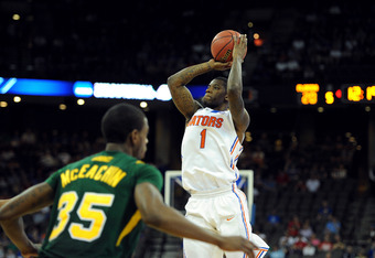 OMAHA, NE - MARCH 18:  Kenny Boynton #1 of the Florida Gators attempts a shot in the first half against Chris McEachin #35 of the Norfolk State Spartans during the third round of the 2012 NCAA Men's Basketball Tournament at CenturyLink Center on March 18,