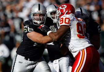 OAKLAND, CA - OCTOBER 21: Guard Cooper Carlisle #66 of the Oakland Raiders tries to hold off defensive tackle Turk McBride #90 of the Kansas City Chiefs at McAfee Coliseum on October 21, 2007 in Oakland, California. Kansas City won 12-10.  (Photo by Allen