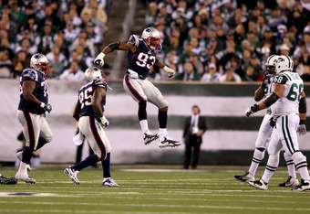 EAST RUTHERFORD, NJ - NOVEMBER 13:   Andre Carter #93 of the New England Patriots celebrates with  Mark Anderson #95 after a sacking  Mark Sanchez #6 of the New York Jets  at MetLife Stadium on November 13, 2011 in East Rutherford, New Jersey.  (Photo by