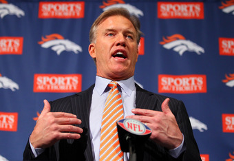 ENGLEWOOD, CO - MARCH 20:  Executive vice president of football operations John Elway speaks during a news conference announcing quarterback Peyton Manning's contract with the Denver Broncos in the team meeting room at the Paul D. Bowlen Memorial Broncos