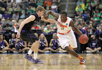 PITTSBURGH, PA - MARCH 17:  Dion Waiters #3 of the Syracuse Orange drives in the second half against Will Spradling #55 of the Kansas State Wildcats during the third round of the 2012 NCAA Men's Basketball Tournament at Consol Energy Center on March 17, 2