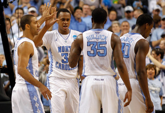 GREENSBORO, NC - MARCH 18:  (L-R) Kendall Marshall #5, John Henson #31, Reggie Bullock #35 and Harrison Barnes #40 of the North Carolina Tar Heels celebrate in the second half while taking on the Creighton Bluejays during the third round of the 2012 NCAA