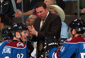DENVER, CO - MARCH 20:  Head coach Joe Sacco of the Colorado Avalanche leads his team during a timeout against the Calgary Flames at Pepsi Center on March 20, 2012 in Denver, Colorado. The Avalanche defeated the Flames 2-1 in overtime.  (Photo by Doug Pen