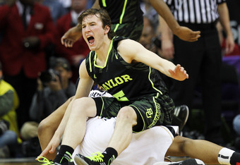 KANSAS CITY, MO - MARCH 10:  Brady Heslip #5 of the Baylor Bears falls onto Steve Moore #32 of the Missouri Tigers in the first half during the championship game of the 2012 Big 12 Men's Basketball Tournament at Sprint Center on March 10, 2012 in Kansas C