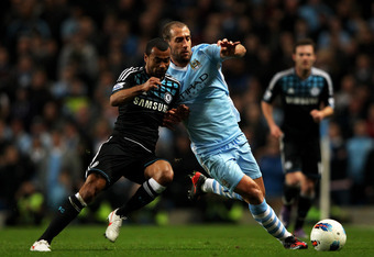 MANCHESTER, ENGLAND - MARCH 21:  Ashley Cole of Chelsea and Pablo Zabaleta of Manchester City compete for the ball during the Barclays Premier League match between Manchester City and Chelsea at the Etihad Stadium on March 21, 2012 in Manchester, England.