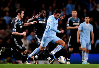 MANCHESTER, ENGLAND - MARCH 21:  Carlos Tevez of Manchester City is pursued by Michael Essien (C) and Frank Lampard (L) of Chelsea during the Barclays Premier League match between Manchester City and Chelsea at the Etihad Stadium on March 21, 2012 in Manc