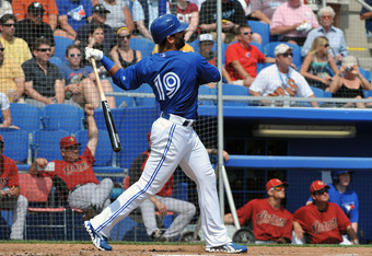 DUNEDIN, FL - MARCH 10: Outfielder Jose Bautista #19 of the Toronto Blue Jays hits a home run against the Houston Astros March 10, 2012 at Florida Auto Exchange Stadium in Dunedin, Florida. (Photo by Al Messerschmidt/Getty Images)
