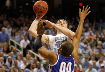 GREENSBORO, NC - MARCH 18:  Tyler Zeller #44 of the North Carolina Tar Heels goes up for a shot over Gregory Echenique #00 of the Creighton Bluejays in the second half during the third round of the 2012 NCAA Men's Basketball Tournament at Greensboro Colis