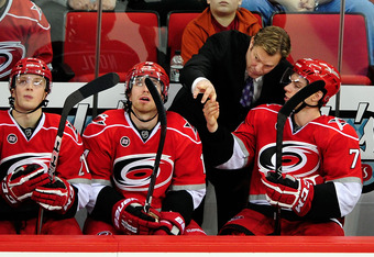 RALEIGH, NC - FEBRUARY 23:  Head coach Kirk Muller confers with Jerome Samson #71 of the Carolina Hurricanes during a game against the Anaheim Ducks at the RBC Center on February 23, 2012 in Raleigh, North Carolina. Anaheim won 3-2 in a shootout.  (Photo