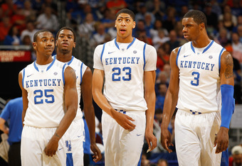 NEW ORLEANS, LA - MARCH 10:  Marquis Teague #25, Michael Kidd-Gilchrist #14, Anthony Davis #23 and Terrence Jones #3 of the Kentucky Wildcats react in the first half against the Florida Gators during the semifinals of the SEC Men's Basketball Tournament a