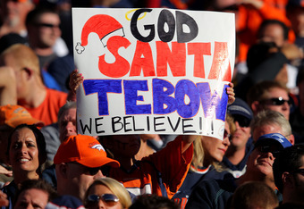 DENVER, CO - DECEMBER 18:  A fan holds up a quarterback Tim Tebow #15 of the Denver Broncos sign during a game against the New England Patriots at Sports Authority Field at Mile High on December 18, 2011 in Denver, Colorado.  (Photo by Doug Pensinger/Gett