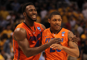 PHOENIX, AZ - MARCH 22:  Patric Young #4 and Bradley Beal #23 of the Florida Gators celebrate the 68-58 victory against the Marquette Golden Eagles during the 2012 NCAA Men's Basketball West Regional Semifinal game at US Airways Center on March 22, 2012 i