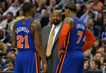 PHILADELPHIA, PA - MARCH 21: Head coach Mike Woodson of the New York Knicks talk with Iman Shumpert #21 and Carmelo Anthony #7 during the game against the Philadelphia 76ers at the Wells Fargo Center on March 21, 2012 in Philadelphia, Pennsylvania. The Kn
