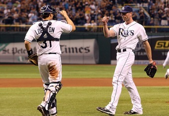 ST. PETERSBURG, FL - SEPTEMBER 24:  Jose Lobaton #31 celebrates with Kyle Farnsworth #31 of the Tampa Bay Rays after getting the final out against the Toronto Blue Jays during the game on September 24, 2011 at Tropicana Field in St. Petersburg, Florida. T