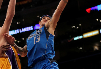 LOS ANGELES, CA - JANUARY 16:  Delonte West #13 of the Dallas Mavericks goes up for a shot against the Los Angeles Lakers at Staples Center on January 16, 2012 in Los Angeles, California. The Lakers won 73-70.  NOTE TO USER: User expressly acknowledges an