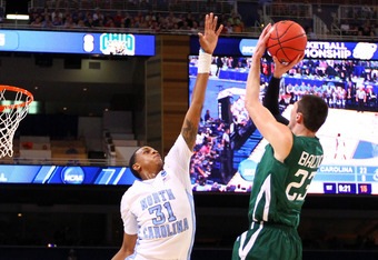 ST. LOUIS, MO - MARCH 23:  John Henson #31 of the North Carolina Tar Heels defends a shot attempt by Ivo Baltic #23 of the Ohio Bobcats during the 2012 NCAA Men's Basketball Midwest Regional Semifinal at Edward Jones Dome on March 23, 2012 in St. Louis, M