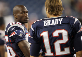 FOXBORO, MA - AUGUST 11:  Chad Ochocinco #85 of the New England Patriots talks with teammate Tom Brady #12 in the fourth quarter against the Jacksonville Jaguars on August 11, 2011 at Gillette Stadium in Foxboro, Massachusetts. The New England Patriots de