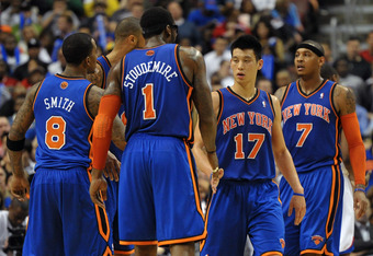 PHILADELPHIA, PA - MARCH 21: Jeremy Lin #17 of the New York Knicks is congratulated by teammate Amare Stoudemire #1 at the Wells Fargo Center on March 21, 2012 in Philadelphia, Pennsylvania. The Knicks won 82-79. NOTE TO USER: User expressly acknowledges