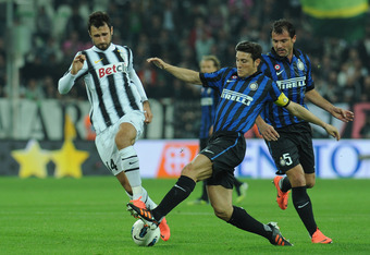 TURIN, ITALY - MARCH 25:  Mirko Vucinic (L) of Juventus FC is challenged by Javier Zanetti of FC Internazionale Milano during the Serie A match between Juventus FC and FC Internazionale Milano at Juventus Arena on March 25, 2012 in Turin, Italy.  (Photo b