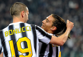 TURIN, ITALY - MARCH 25:  Jose Martin Caceres #4 and  Leonardo Bonucci (L) of Juventus FC celebrates scoring the first goal during the Serie A match between Juventus FC and FC Internazionale Milano at Juventus Arena on March 25, 2012 in Turin, Italy.  (Ph