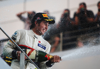 KUALA LUMPUR, MALAYSIA - MARCH 25:  Sergio Perez of Mexico and Sauber F1 celebrates on the podium after finishing second during the Malaysian Formula One Grand Prix at the Sepang Circuit on March 25, 2012 in Kuala Lumpur, Malaysia.  (Photo by Ker Robertso