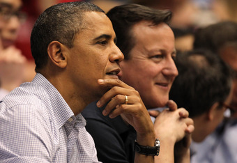 DAYTON, OH - MARCH 13:  U.S. President Barack Obama (L) and British Prime Minister David Cameron (R) watch the action at UD Arena in the first half as the Western Kentucky Hilltoppers take on the Mississippi Valley State Delta Devils in the first round of