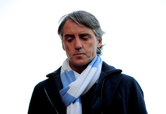 STOKE ON TRENT, ENGLAND - MARCH 24:  Roberto Mancini the manager of Manchester City looks on prior to kickoff during the Barclays Premier League match between Stoke City and Manchester City at the Britannia Stadium on March 24, 2012 in Stoke on Trent, Eng