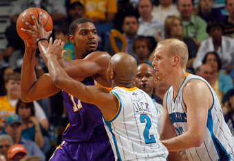NEW ORLEANS, LA - MARCH 14:  Andrew Bynum #17 of the Los Angeles Lakers looks to pass the ball around Jarrett Jack #2 of the New Orleans Hornets at the New Orleans Arena on March 14, 2012 in New Orleans, Louisiana.  NOTE TO USER: User expressly acknowledg