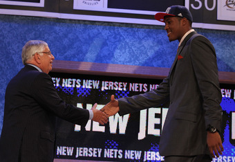 NEW YORK - JUNE 24:  Derrick Favors of Georgia State stands with NBA Commisioner David Stern after being drafted by the New Jersey Nets at Madison Square Garden on June 24, 2010 in New York City.  NOTE TO USER: User expressly acknowledges and agrees that,