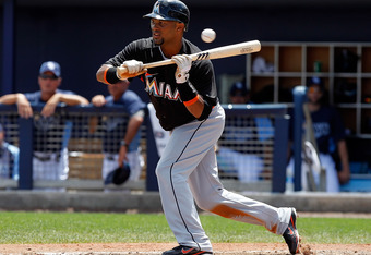 PORT CHARLOTTE, FL - MARCH 25:  Outfielder Emilio Bonifacio #1 of the Miami Marlins attempts a bunt against the Tampa Bay Rays during a Grapefruit League Spring Training Game at the Charlotte Sports Complex on March 25, 2012 in Port Charlotte, Florida.  (