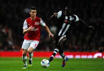 LONDON, ENGLAND - MARCH 12:  Laurent Koscielny of Arsenal and Demba Ba of Newcastle battle for the ball during the Barclays Premier League match between Arsenal and Newcastle United at Emirates Stadium on March 12, 2012 in London, England.  (Photo by Mike