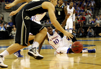 OMAHA, NE - MARCH 18:  Tyshawn Taylor #10 of the Kansas Jayhawks looks up from the court in the first half as the Purdue Boilermakers pick up the dribble during the third round of the 2012 NCAA Men's Basketball Tournament at CenturyLink Center on March 18