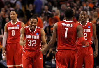BOSTON, MA - MARCH 24:  Deshaun Thomas #1, Sam Thompson #12, Jared Sullinger #0 and Lenzelle Smith, Jr. #32 of the Ohio State Buckeyes celebrates towards the end of the game against the Syracuse Orange during the 2012 NCAA Men's Basketball East Regional F