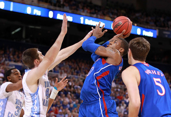 ST LOUIS, MO - MARCH 25:  Thomas Robinson #0 of the Kansas Jayhawks attempts a shot in the first half against Tyler Zeller #44 of the North Carolina Tar Heels during the 2012 NCAA Men's Basketball Midwest Regional Final at Edward Jones Dome on March 25, 2