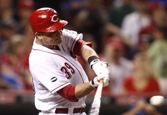 CINCINNATI, OH - SEPTEMBER 12:   Devin Mesoraco #39 of the Cincinnati Reds connects for his first career Major League home run during the game against the Chicago Cubs on September 12, 2011 at Great American Ball Park in Cincinnati, Ohio.  The Cubs defeat