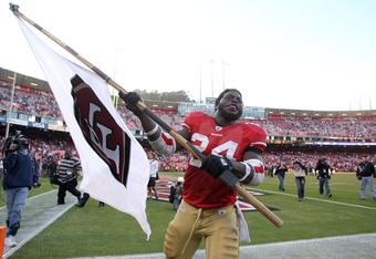 SAN FRANCISCO, CA - DECEMBER 04:  Anthony Dixon #24 of the San Francisco 49ers celebrates after they beat the St. Louis Rams at Candlestick Park on December 4, 2011 in San Francisco, California.  (Photo by Ezra Shaw/Getty Images)