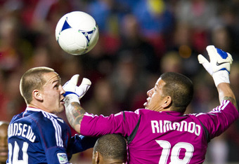 SANDY, UT - MARCH 24: Casey Townsend #14 of Chivas USA goes up to score against Nick Rimando #18 of Real Salt Lake and Chris Schuler #28 of Real Salt Lake during the second half at Rio Tinto Stadium on March 24, 2012, in Sandy, Utah. (Photo by Doug Pizac/