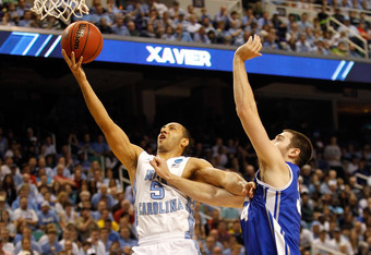 GREENSBORO, NC - MARCH 18:  Kendall Marshall #5 of the North Carolina Tar Heels is fouled by Ethan Wragge #34 of the Creighton Bluejays in the second half during the third round of the 2012 NCAA Men's Basketball Tournament at Greensboro Coliseum on March