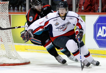 RIMOUSKI, QC - MAY 24:   Ryan Ellis #6 of the Windsor Spitfires skates with the puck while being chased by Stepan Novotny #9 of the Kelowna Rockets during the 2009 Mastercard Memorial Cup Final at the Rimouski Colisee on May 24, 2009 in Rimouski, Quebec,