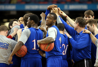 NEW ORLEANS, LA - MARCH 30:  (C) Tyshawn Taylor #10 of the Kansas Jayhawks huddles with his team during practice prior to the 2012 Final Four of the NCAA Division I Men's Basketball Tournament at the Mercedes-Benz Superdome on March 30, 2012 in New Orlean