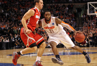 BOSTON, MA - MARCH 24:  Scoop Jardine #11 of the Syracuse Orange handles the ball against Aaron Craft #4 of the Ohio State Buckeyes during the 2012 NCAA Men's Basketball East Regional Final at TD Garden on March 24, 2012 in Boston, Massachusetts.  (Photo